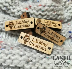 Detailed engraving on wooden tags by Laser Gallery